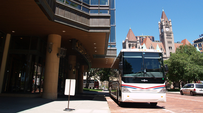 Charter bus providing conference transportation